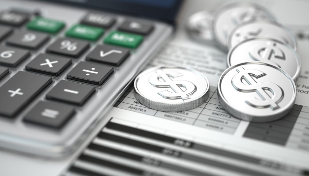 Financial concept. Calculator, coins and graph.