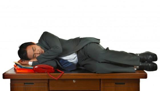 Tired Businessman Having A Sleep