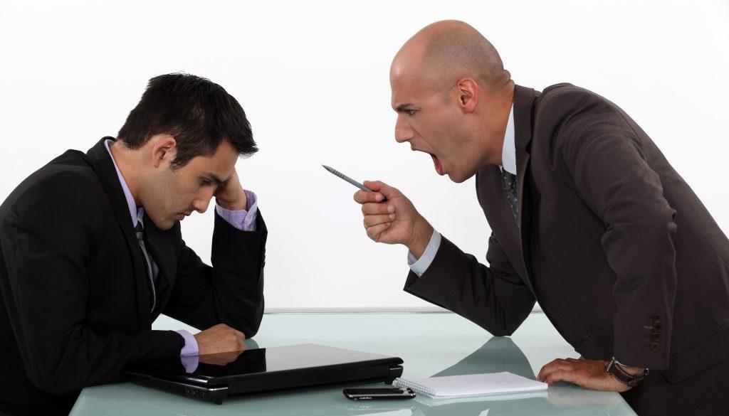 Boss shouting at employee