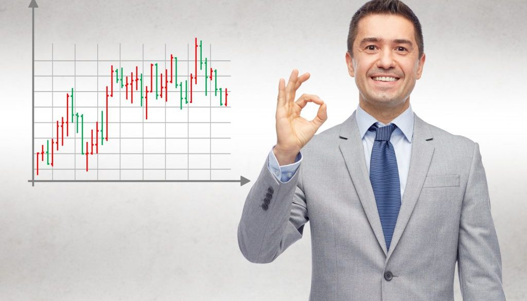 happy businessman in suit showing ok hand sign