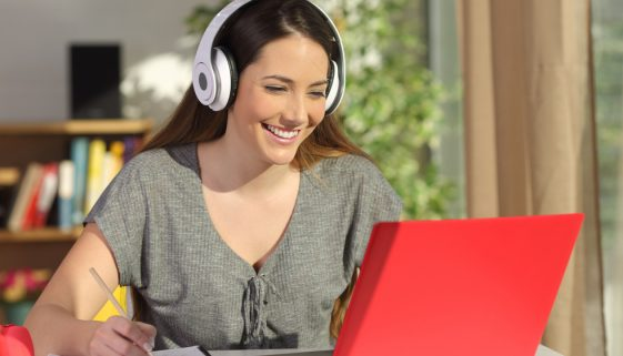 Student learning on line with a laptop and headphones