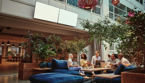 Smiling businesspeople relaxing in the lounge area of an office